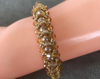 Beige gold beaded bracelet, gold bracelet, beige bracelet, done in right angle weave, with beige crystals, pearls.
