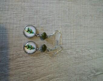 pierced ears pattern feather