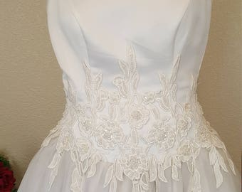Gorgeous white wedding dress by Jasmine. Simply adorned with lace along waist and train./ Bride/Chiffon/ Satin