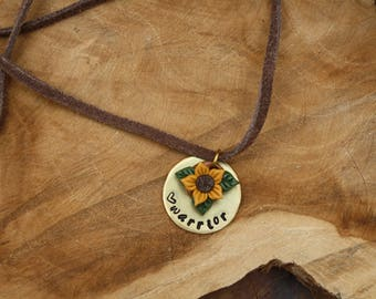 Warrior necklace with a little flower charm, handstamped jewelry