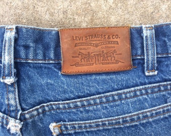 Vintage 70's Levi's Denim Jeans with leather patch, orang tag and stitching.
