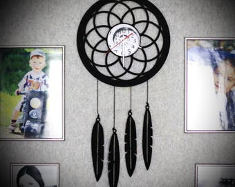 """Wall clock """"catcher times"""" made from vinyl records."""