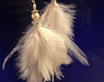 Feather white earrings