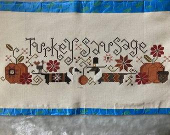 "Unframed / Stitched / Completed Cross Stitch - ""Turkey Sausage"""