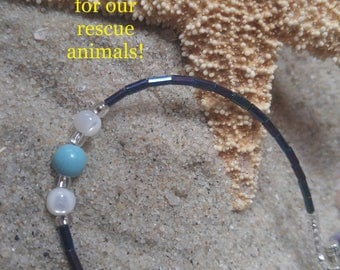 Bracelet  turquoise, iridescent glass  bugle  beads,  glass seed beads, teal blue white original design. Purchase benefits rescue animals.