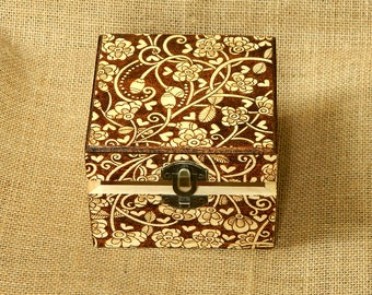 Beautiful floral wooden pyrography box richly decorated with flowers and hearts
