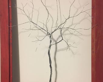 Wire tree on red frame