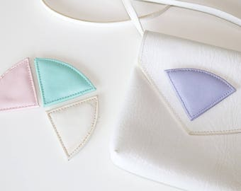 Totally rad 80s white bag with interchangeable triangle patches in pastel colours