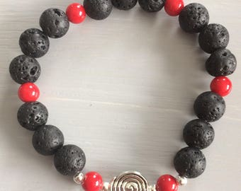 Bracelet in black lava and Red jade with charms