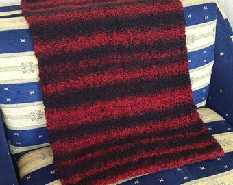 Very soft red black striped knitted rug. 25 % wool. Handmade in EU.