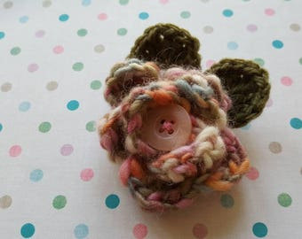 Lovely crochet multi coloured flower brooch with button centre