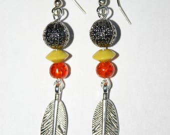 Dangling silver feather and beads