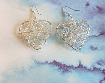 Hand made wire silver heart earrings. Dangle drop earrings.