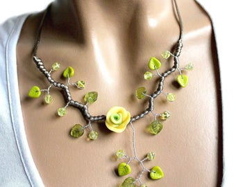 Necklace green leaves and yellow flower