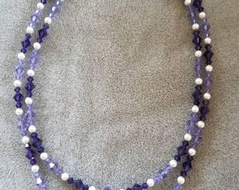 18 inch and 15 inch double strand purple and lavender Swarovski crystal and off white Swarovski pearl necklace.