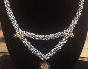 "Chainmail ""Sunfire"" necklace using a tight Byzantine weave."