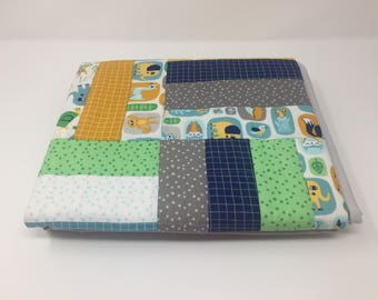 """Lily & Loom Z is for Zoo baby quilt. 100% Cotton backed in grey minky. Blue and green color scheme. 36.5"""" wide x 44.5"""" long."""