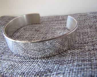 Sterling silver retangular bangle.
