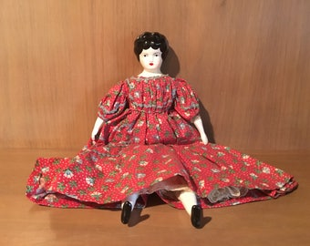 Antique Porcelain Doll with Black Hair, Painted Face, Bisque Head, Hands, Feet, stuffed body