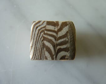 Cubes are hand-shaped marbled terracotta