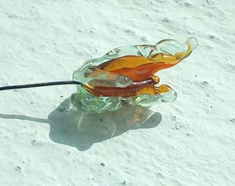 Flame - exotic flower in glass on copper wire