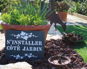 """Decorative slate to be put on the theme """"settle Garden"""""""