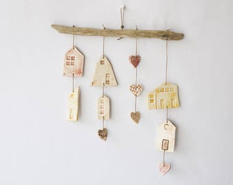Driftwood mobile and little houses ceramic hearts in pastel colors
