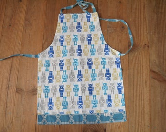 """Reversible apron, for boy 2 to 10 years approximately """"blue Robots"""""""