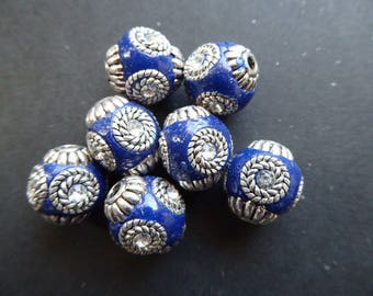 1 blue 14 mm hole 2 mm Indonesian bead