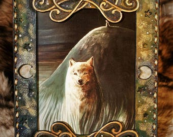 Frame in embossed leather and fine art reproduction of dreamlike fantasy illustration White Wolf in the Moonlight
