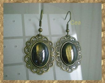Print and black cabochon earrings