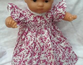 dress has smocking has pink flowers, ruffle sleeve doll 36 cm