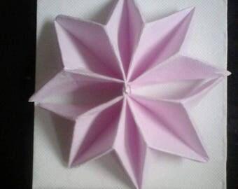 Pink snowflake shaped napkin folding
