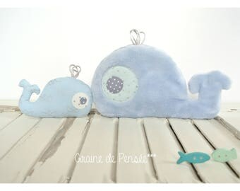 Whale plushie with a Pocket that hides all its p' little baby whale