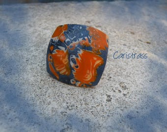 Blue and orange square ring polymer clay.