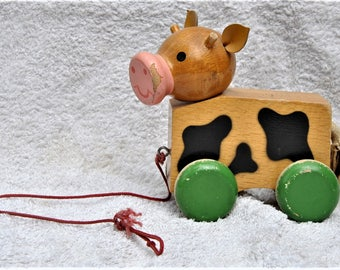 Vintage wooden pig with wheels