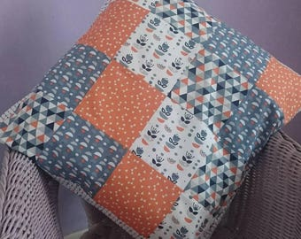 Tall tales tangerine orange patchwork cushion