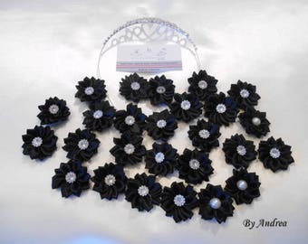 Small applique fabric flowers in black satin with Rhinestones.