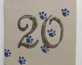 Number of door 20 decorated stoneware cat paws