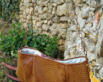 bag has handmade Brown faux and chain