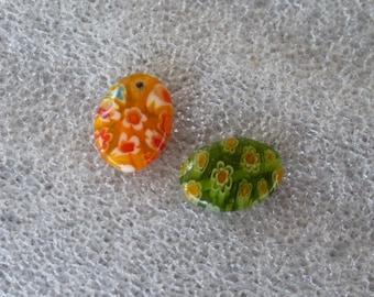 2 flat oval beads 14 mm 1 orange millefiori glass beads and 1 green