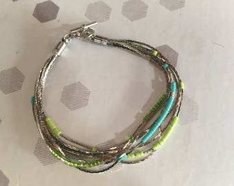 the bracelet 8 strands and these blue and green beads