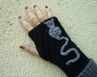 Black wool mittens with a grey cat