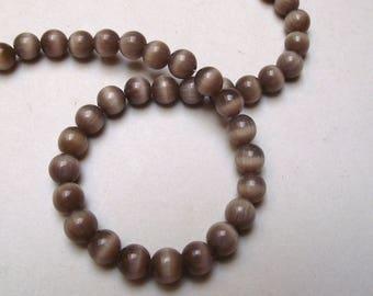 Set of 20 Brown cat eye beads / beige 6 mm.