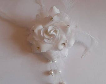 back train, brooch or boutonniere white and rhinestones