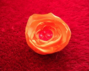 Clip has satin fabric, vinyl and leather red and orange hair