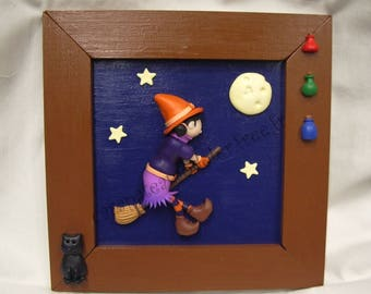 Painting little witch on her broom in the Moonlight