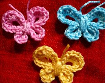set of 3 butterflies in pink, light blue and light yellow cotton crochet