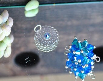 Pendant Swarovski bicone spacer beads and silver filigree bead