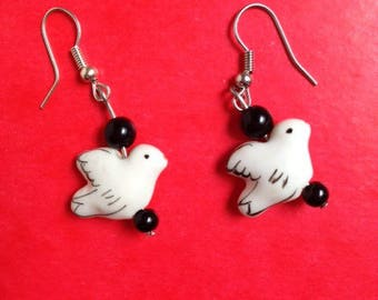 pair of porcelain bird and black beads earrings